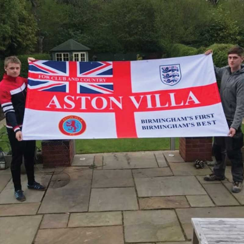 Two lads holding Aston Villa custom football 8ft x 4ft Flag designed on Ultras Design website
