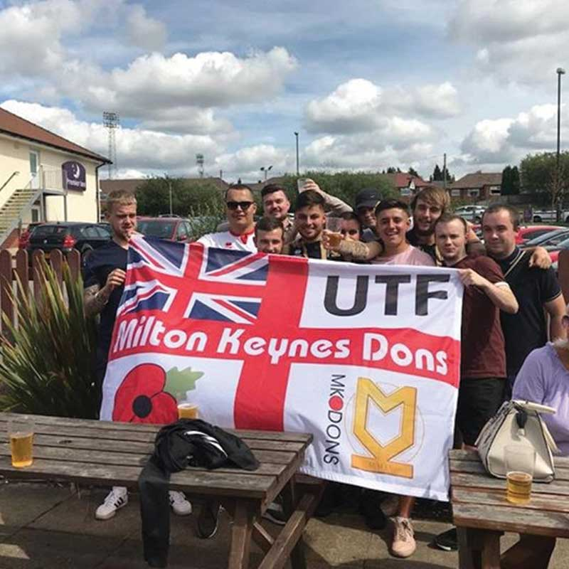 Bunch of lads holding Milton Keynes Dons St George + Union Jack personalised football Flag UTF
